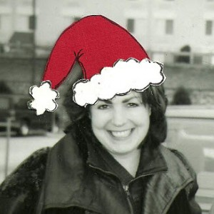 A picture of Yvonne deSousa in a Santa hat